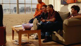 Four Men Watching Television
