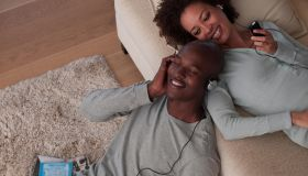 A couple listening to music together