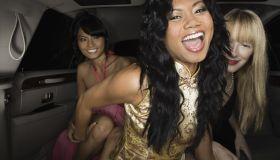 Multi-ethnic women laughing in limousine