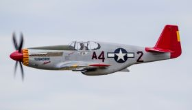 A P-51 Mustang flies by at EAA Airventure, Oshkosh, Wisconsin.