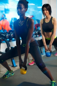 Young people exercising with Kettlebell in a gym Sports training