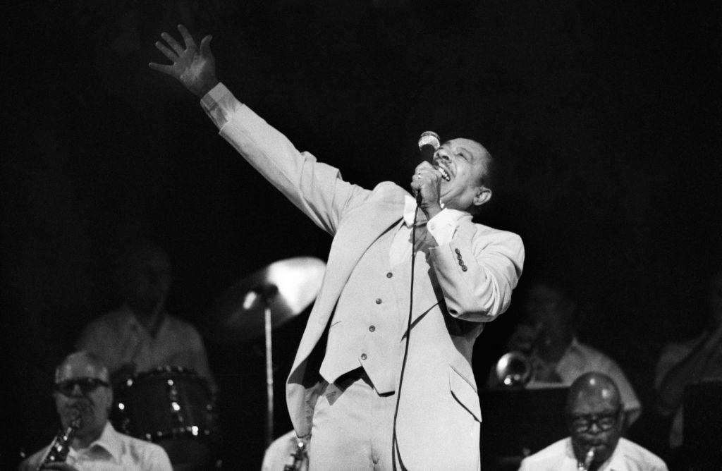 Cab Calloway Singing with Arm Raised